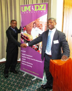 Tione handshake at Umodzi launch